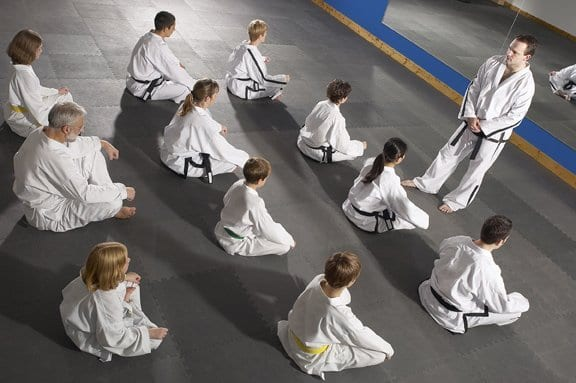 martial arts instructor teaching a seated class